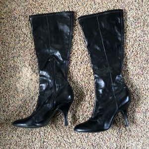 Tall black dress boots with 3 inch heel.